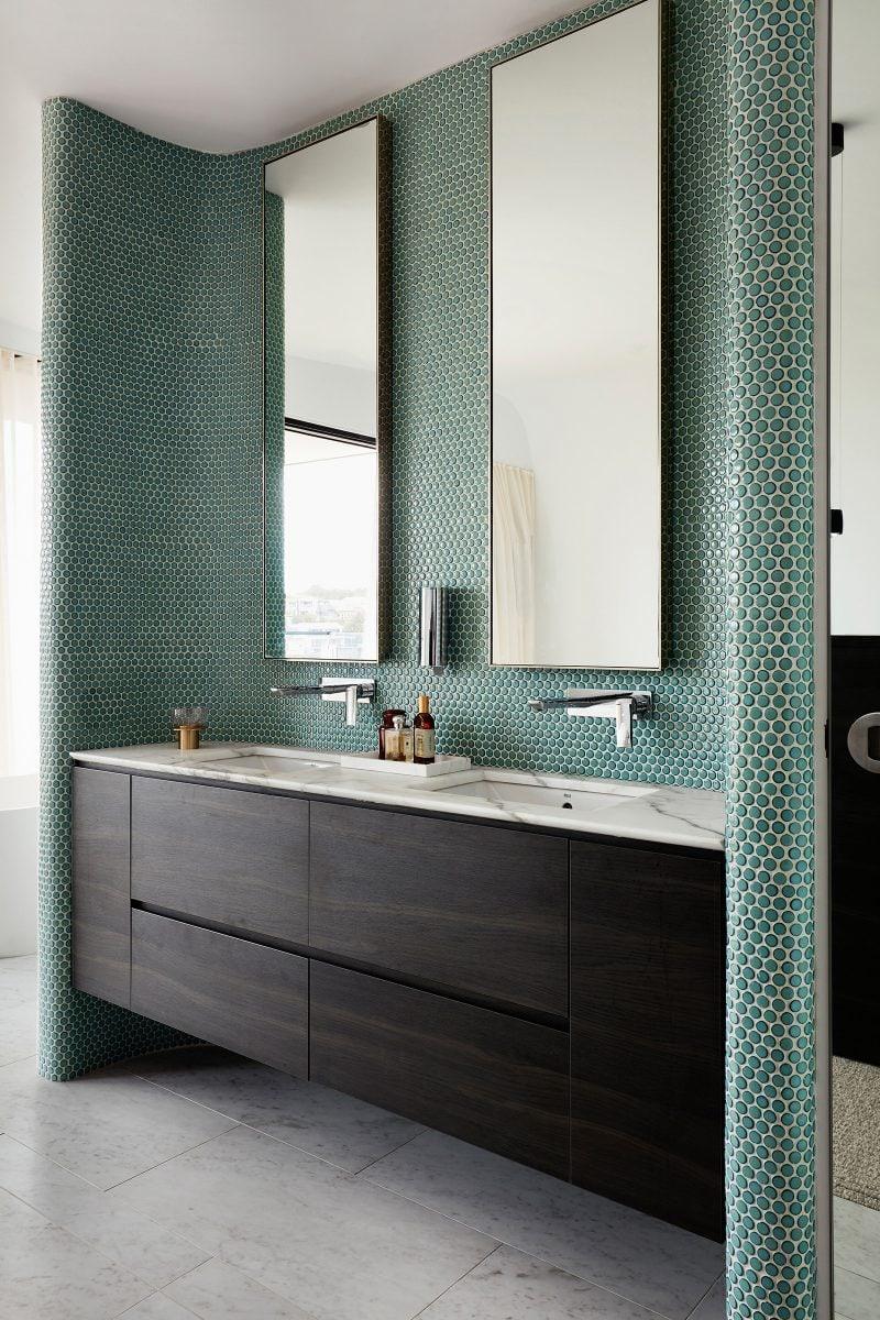 Luigi Rosselli interior, geometric Bathroom tiled mosaic with marbled floor and basin.