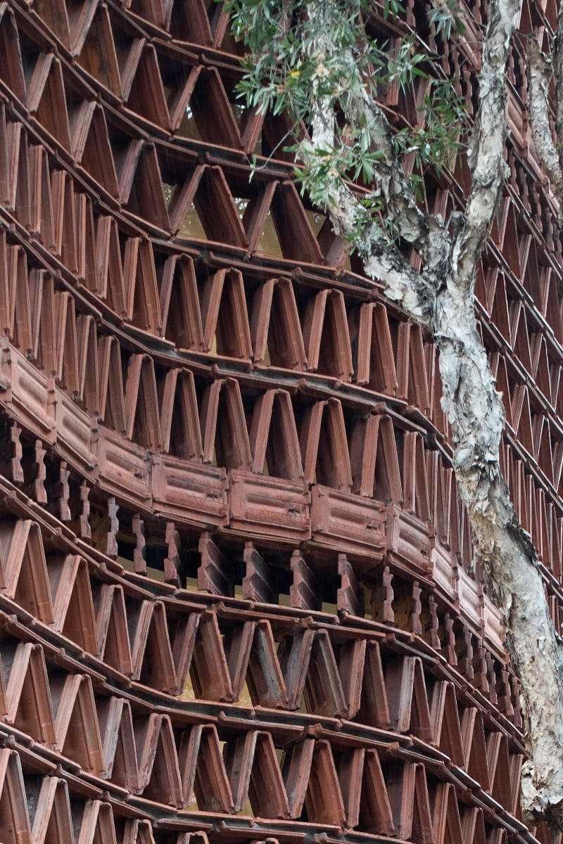 Luigi Rosselli Architects The Beehive studio rhythmic terracotta brise-soleil in triangular pattern