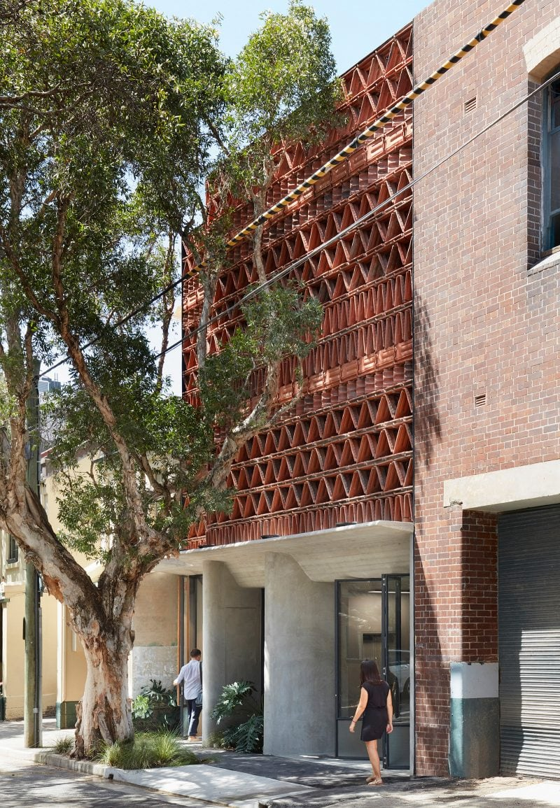 Luigi Rosselli Architects The Beehive studio exposed off form concrete awning with recycled terracotta tile facade