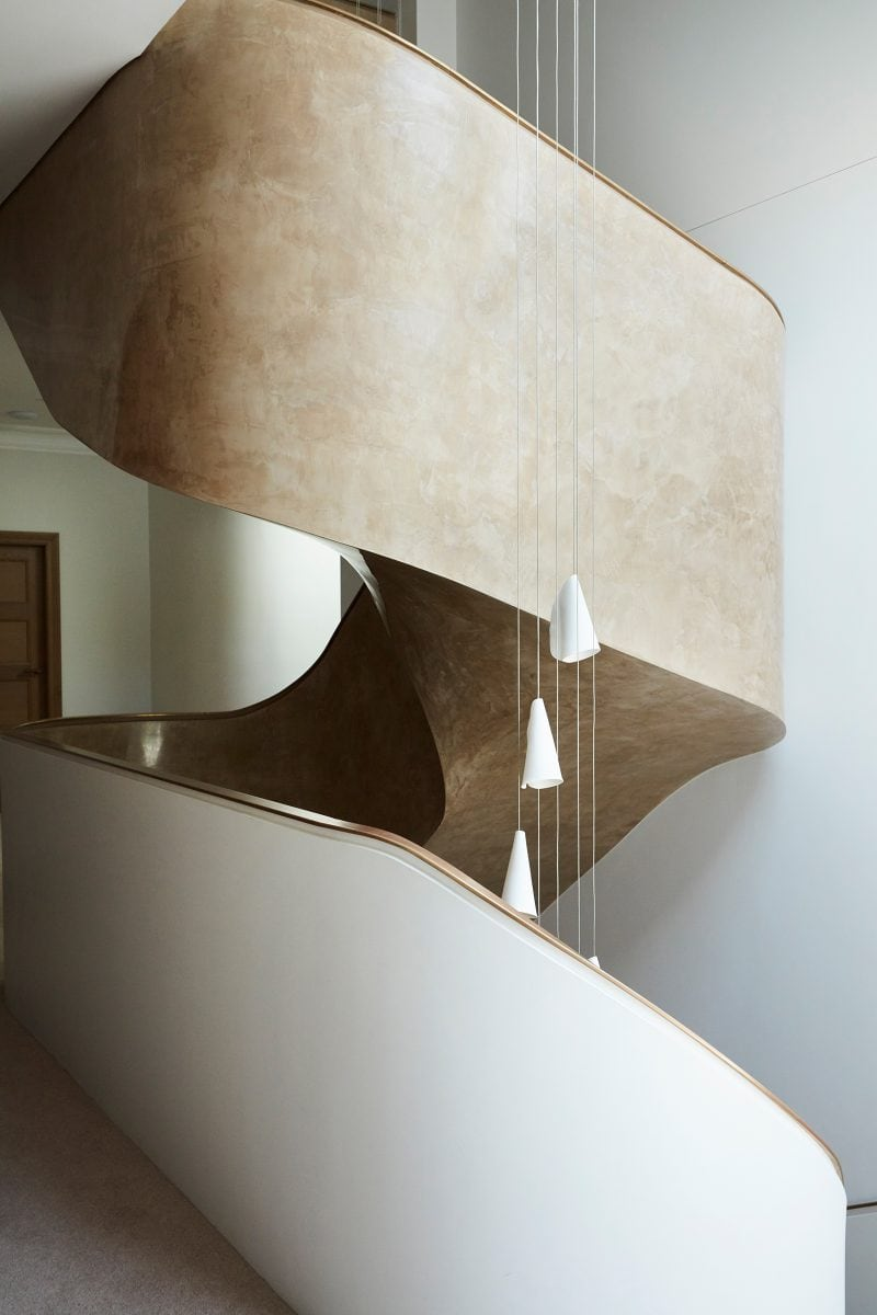 Luigi Rosselli Architects, suspended sculptural ribbon stairs, twisting stairs, pendant light, stuco paint