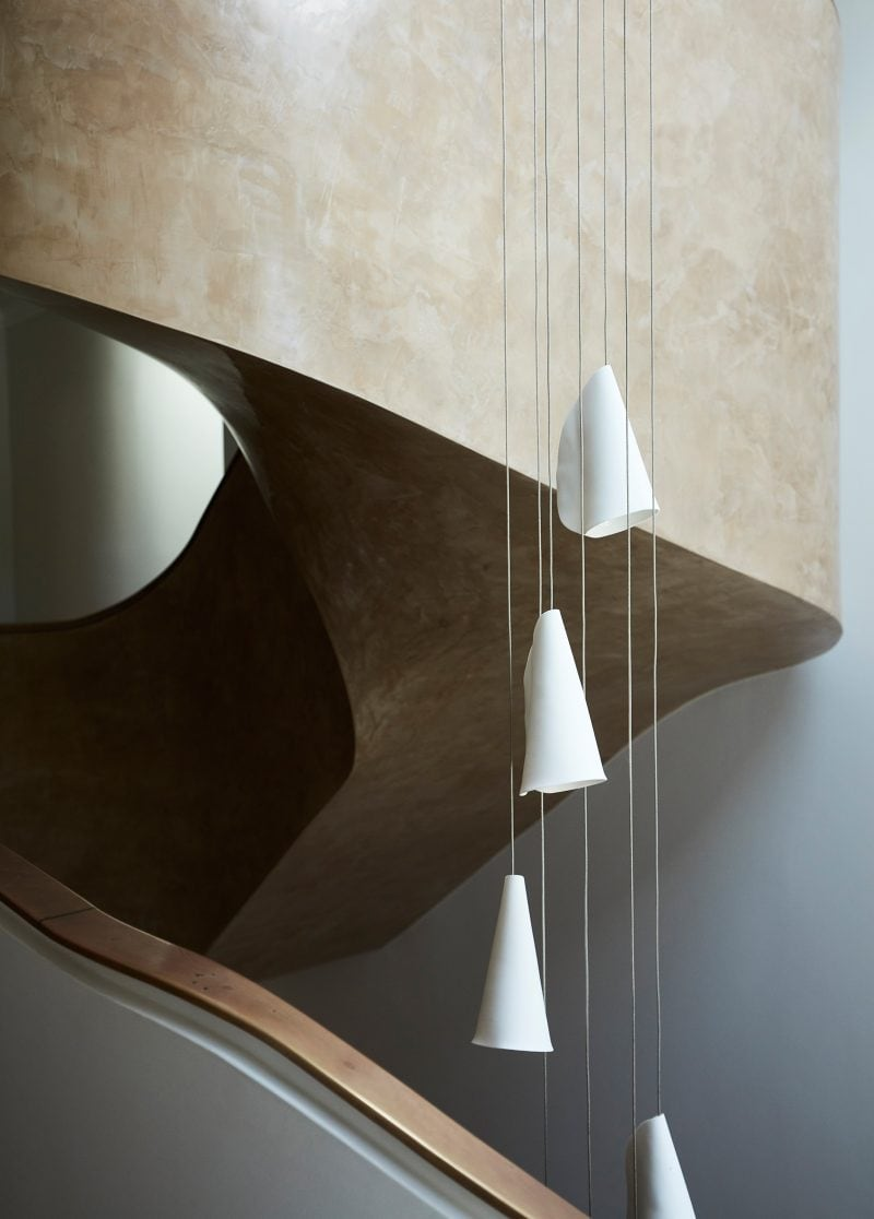 Luigi Rosselli Architects, sculptural stairs, twisting stairs, pendant light, stuco paint