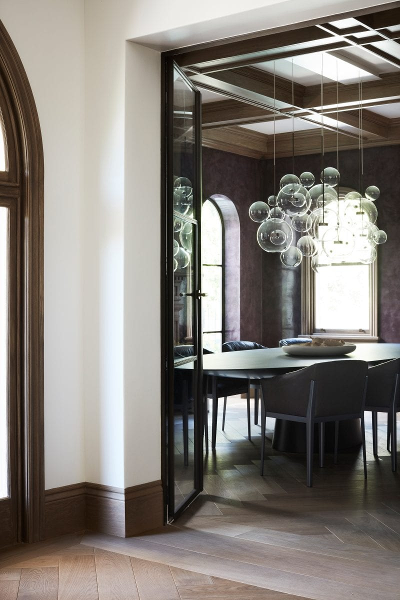 Luigi Rosselli Architects, bubble chandeliers, steel sliding pocket doors, dining, stuco painte walls