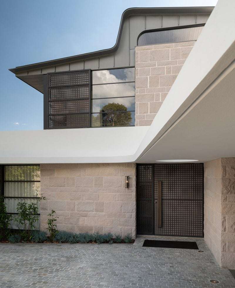 Luigi Rosselli Architects, sandstone, concrete awning, circular skylight, woven brass mesh screen, cobbles courtyard, woollarha house, sydney house, Sydney architecture, Woollahra architecture