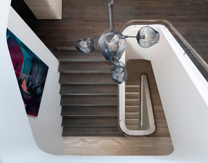 Luigi Rosselli Architects, stairwell, pendant light, stairs, timber handrail, timber flooring, travertine, Woollarha house, Sydney house, residential architecture, Sydney architecture, Woollahra architecture