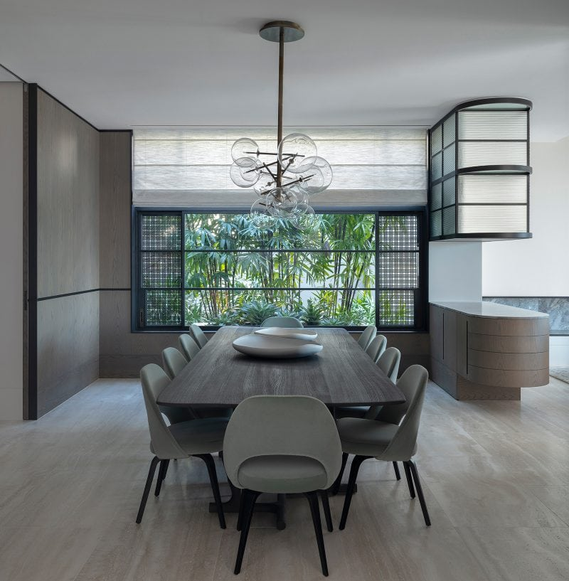 Luigi Rosselli Architects, interior design, dining room, travertine flooring, travertine floor, Woollarha house, Sydney house, residential architecture, dining room, steel windows, mueble bar, timber wall paneling, Sydney architecture, Woollahra architecture, bar joinery, chandelier